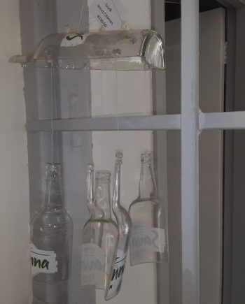 Recycled bottle wind chime/mobile Half bottle or sliced bottle